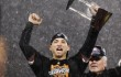 Giants Scutaro holds the MVP trophy after being named most valuable player after his team defeated the St. Louis Cardinals in the NLCS during Game 7 in their MLB NLCS playoff baseball series in San Francisco