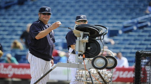 Yankees' pitching machine, nicknamed 'Iron Mike,' fires off 90 mph fastballs during an intrasquad game.
