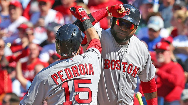 David Ortiz greets Dustin Pedroia after his second home run of the day.