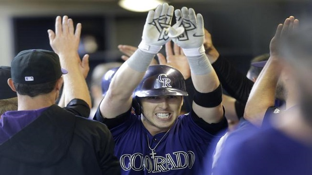 Corey Dickerson celebrates in the dugout after his first home run of the season.