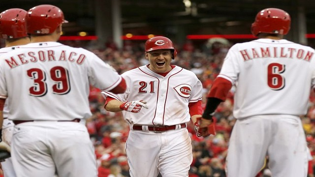 Todd Frazier is greeted by teammates at home plate after his Opening Day home run.