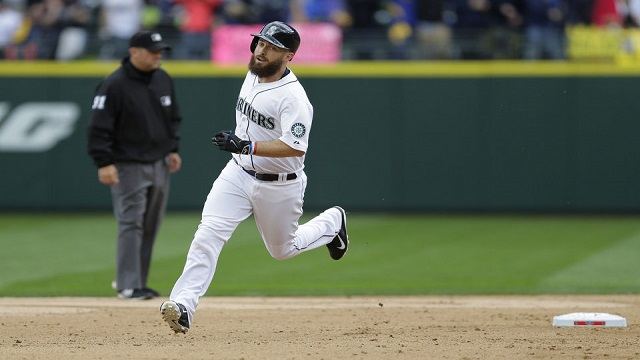 Dustin Ackley rounds the bases after his solo home run.