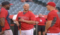 ANAHEIM, CA - AUGUST 08: David Ortiz  #34 of the Boston Red Sox jokes with Albert Pujols #5 and Mike Trout #27 of the Los Angeles Angels of Anaheim before the game on August 8, 2014 at Angel Stadium of Anaheim in Anaheim, California. (Photo by Matt Brown/Angels Baseball LP/Getty Images)