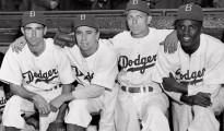FILE: From left, Brooklyn Dodgers baseball players John Jorgensen, Pee Wee Reese, Ed Stanky and Jackie Robinson pose at Ebbets Field in New York on April 15, 1947.