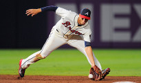Jul 28, 2013; Atlanta, GA, USA; Atlanta Braves shortstop Andrelton Simmons (19) fields a ground ball to begin a double play against the St. Louis Cardinals during the sixth inning at Turner Field. The Braves defeated the Cardinals 5-2. Mandatory Credit: Dale Zanine-USA TODAY Sports