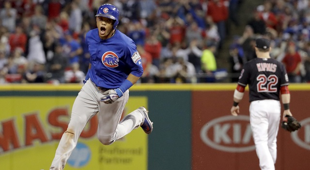 The Chicago Cubs' Addison Russell celebrates after his grand slam against the Cleveland Indians during the third inning of Game 6 of the World Series Tuesday in Cleveland.