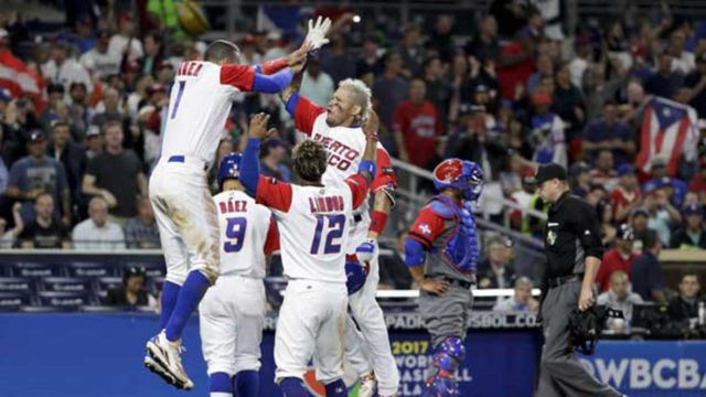 Team Puerto Rico celebrates their 3-1 victory over the Dominican Republic Tuesday night in San Diego.